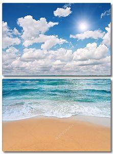 Пляж и море с облаками
