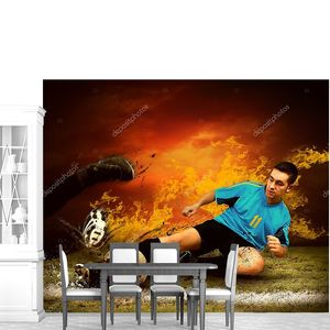 Футболист в огне пламени на открытом поле
