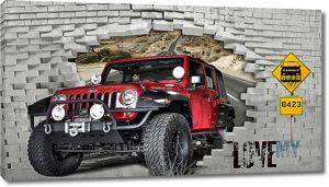 Красный джип пробивает кирпичную стену