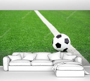 Футбольный мяч на стадионе