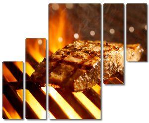 Кусок мяса на гриле
