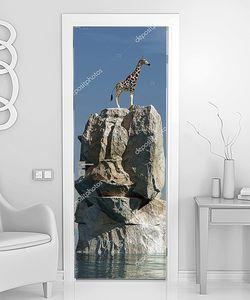 Жираф на скале