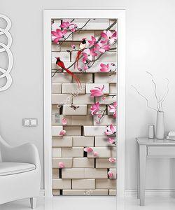 Яркая птичка на ветке с кирпичной стеной