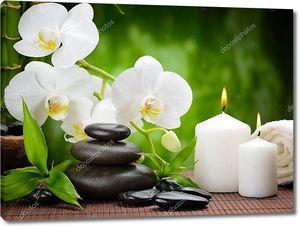 Базальтовые камни и орхидеи со свечками