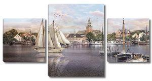 Лодки и парусники на воде у города