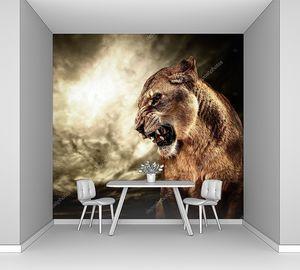 Львица на фоне штормового неба