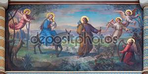 Вена, Австрия - 17 февраля 2014: бегство Святого семейства в Египет фреска Йозеф Кастнер из 1906-1911 годах в церкви кармелитов в dobling.