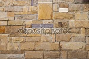 Каменная оранжевая стена