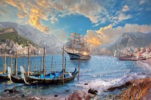 Лодки и корабль в море рядом с городом