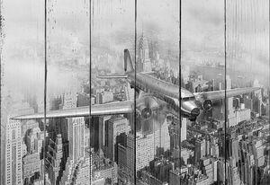 Моторный самолет летит над Нью-Йорком