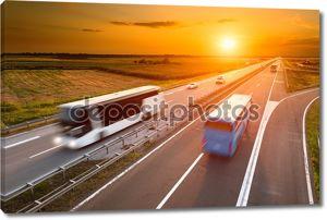 два автобуса на трассе в движение blur