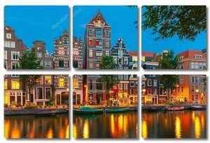 Ночной вид города Амстердам канал с голландского дома