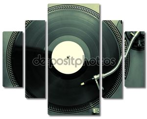 Top view of old fashioned turntable playing a track