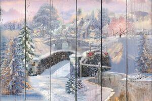 Мост в снежном лесу