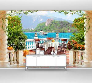 Вид с террасы на катер в море