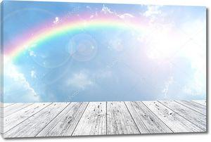 деревянная терраса и голубое небо с радуги