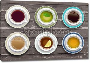Набор чашек кофе и чая. деревянный фон