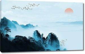 Закат в туманных горах
