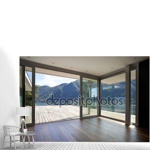 Красивый пентхаус с большим окном и видом на горы