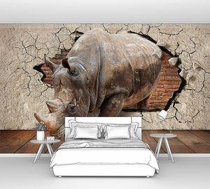 Носорог из стены с кирпичной стеной на заднем фоне