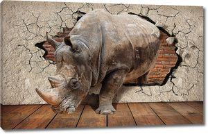 Носорог с кирпичной стеной на заднем фоне