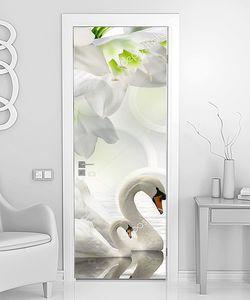 Лебеди в окружении  белых цветов