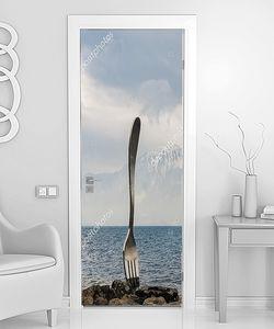 Вилка на фоне моря