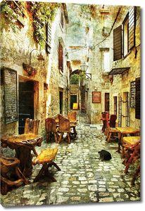 Уютная улочка с маленькими кафе