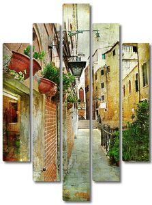 Различные дома на узкой улице