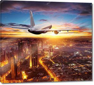 Самолет пролетает над городом Дубай