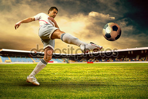 Happiness football player after goal on the field of stadium wit