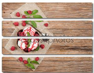 мороженое со свежей малиной и листья сверху на столе