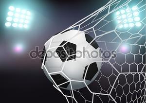 Футбольный мяч в ворота на стадионе с подсветкой