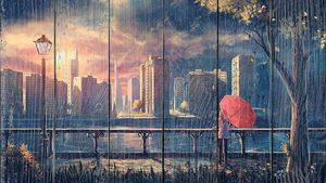 Девушка с зонтом на набережной