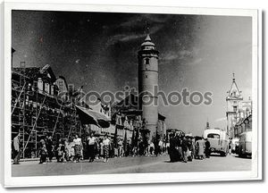 Retro photo shows a view of the city street (square). Black & white vintage photography