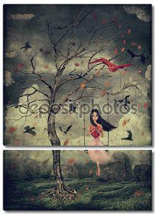 Девушка на качели в лесу