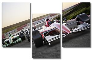 красный гоночный автомобиль закрывает вид спереди на следе, опережающем других с размытым изображением