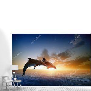 Пара дельфинов в прыжке