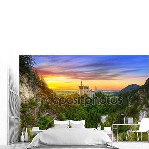 Neuschwanstein Castle in the Bavarian Alps at sunset