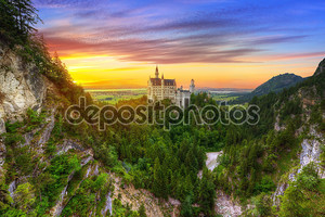Neuschwanstein Castle in the Bavarian Alps at sunset