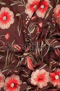 Шелковые ткани текстуры темно-коричневый с ярким цветочным узором
