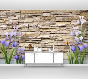 Ирисы на фоне каменной стены