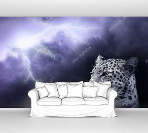Леопард на фоне  молнии