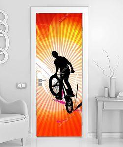 Велогонщик в цветных линиях