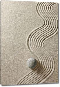 Камень на фоне песка
