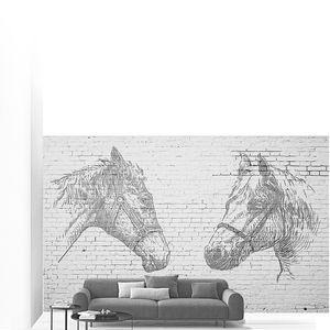Головы лошадей на кирпичной стене