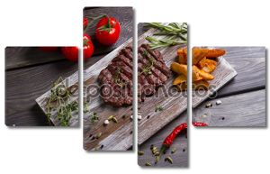 Meat and rosemary on wooden background.