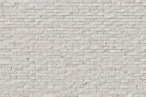 Современный белый камень кирпичной стены