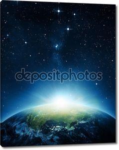 Земля с восходом солнца