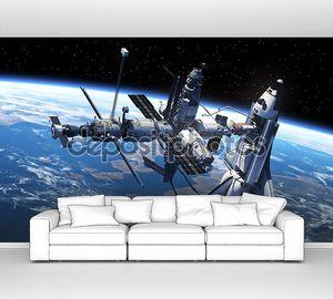 шаттл и космическая станция в космосе